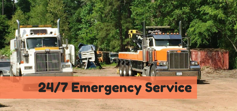 White and orange service trucks in parking lot - 24/7 service